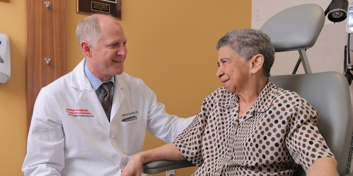Dr. Lustig with an older female patient