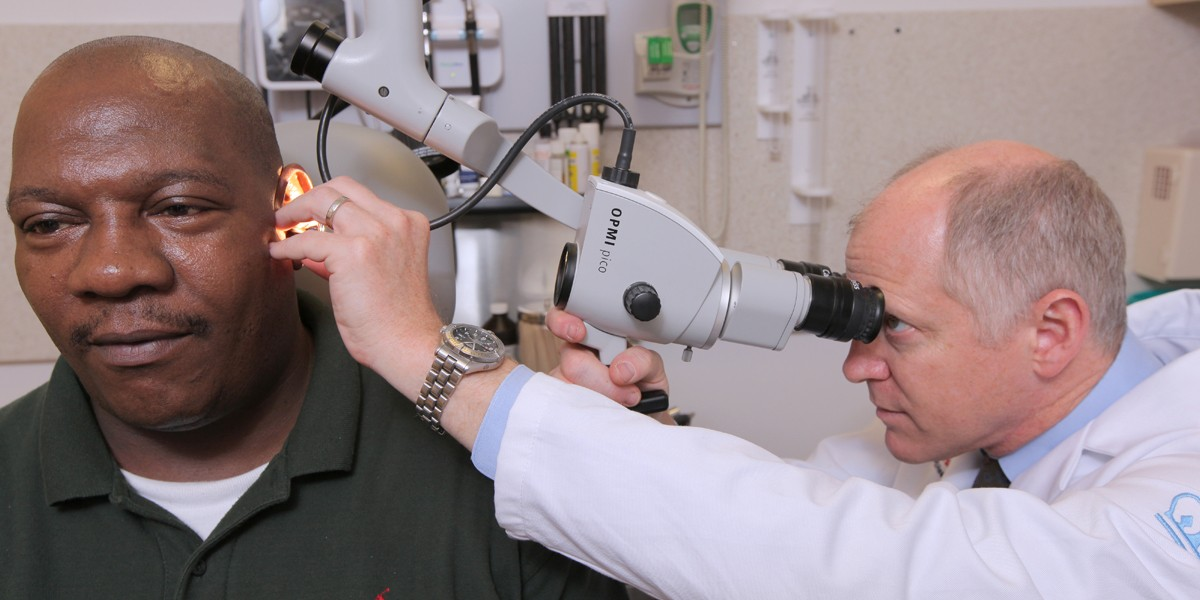 Dr. Lustig looking into a patient's ear